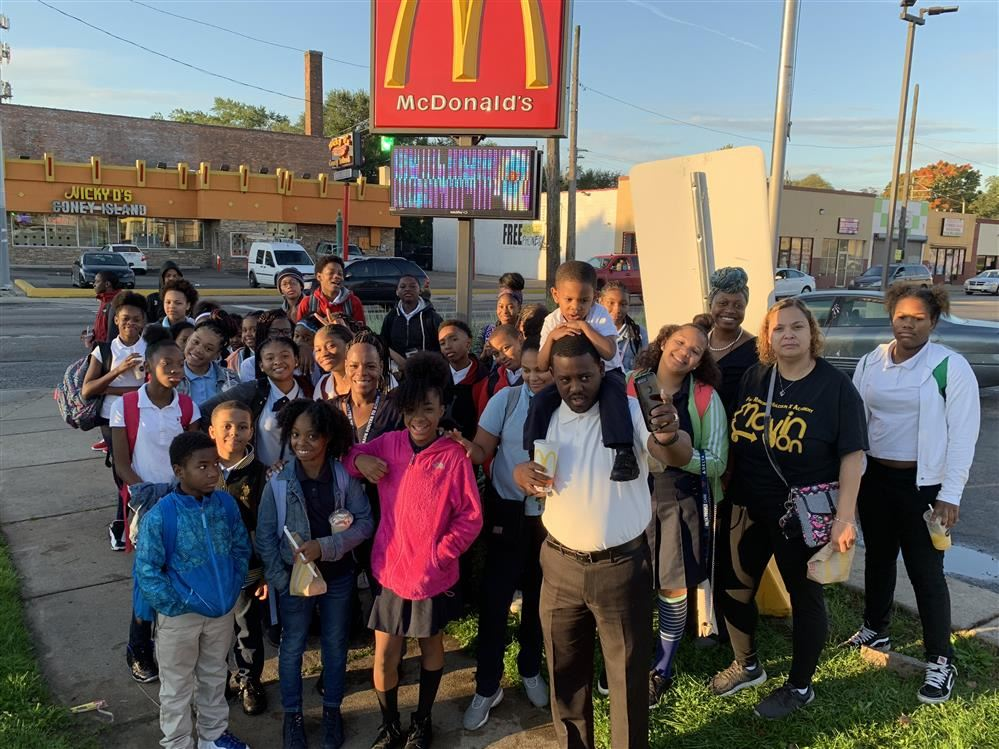 Students outside of McDonald's for national Walk to School Day