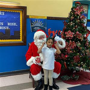 Student posing with Santa.