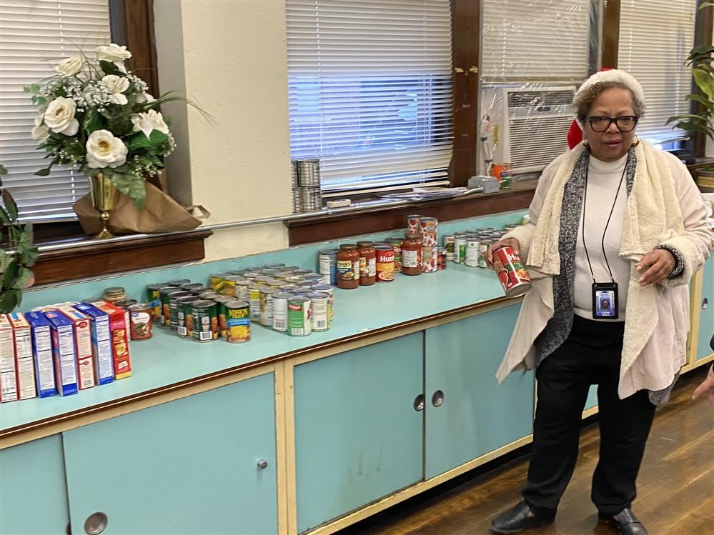 Ms. Carter filling boxes with canned goods.