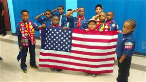 Boy Scouts holding an American flag.