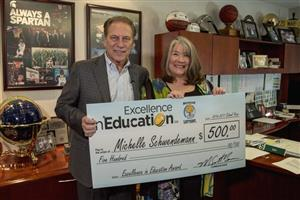 Michelle Schwendemann accepts excellence in education award