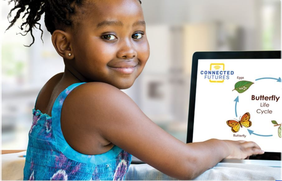 girl smiling at camera with laptop in the background that says connected futures