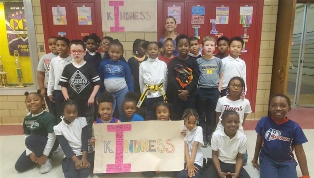 Picture of FLICS students holding Posters for Kindness week