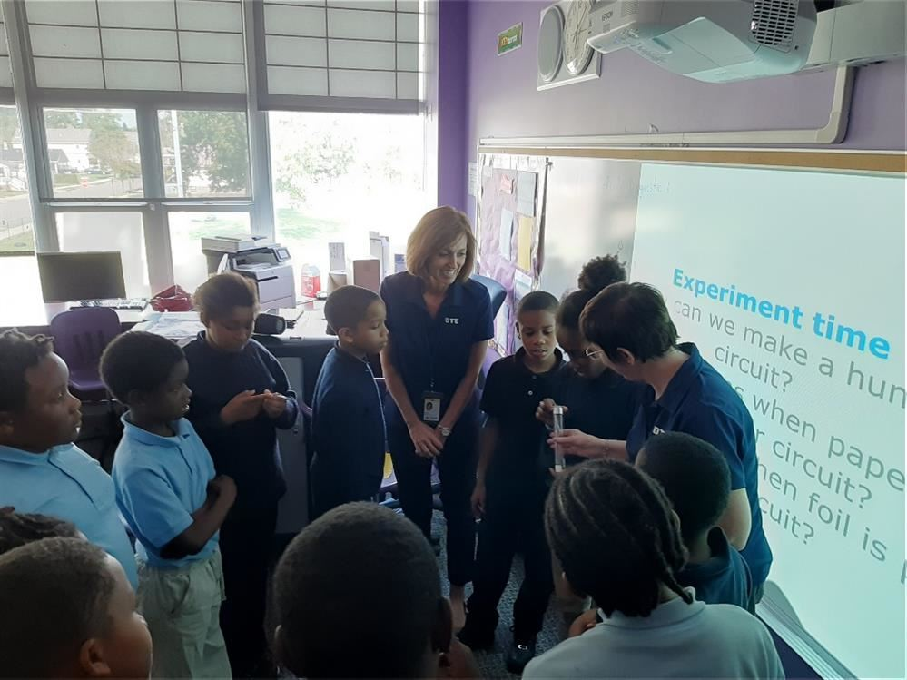 DTE employee teaching students