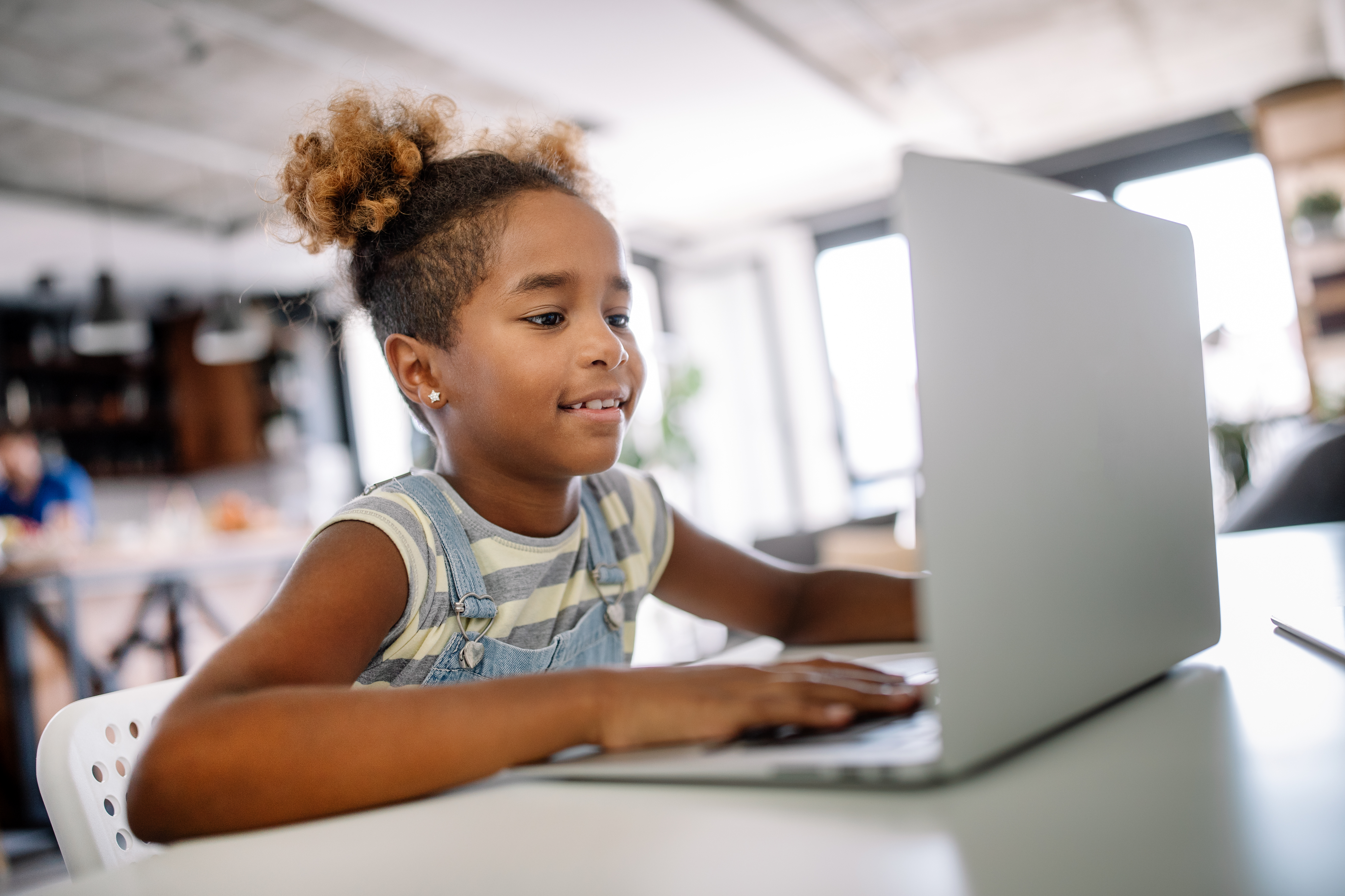 Little girl on laptop